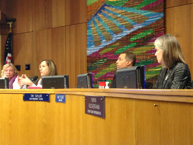 Board Member Gina Daleiden (left) lays out board procedure as Sheila Allen (far left), Tim Taylor (right) and Nancy Peterson (far right) look on.