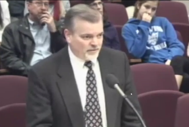 Robert Peterson, husband of School Board Member Nancy Peterson, addresses School Board on Thursday.